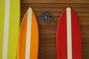 Surfboards agains a wood slatted wall