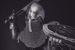Black and white picture of a knight in battle