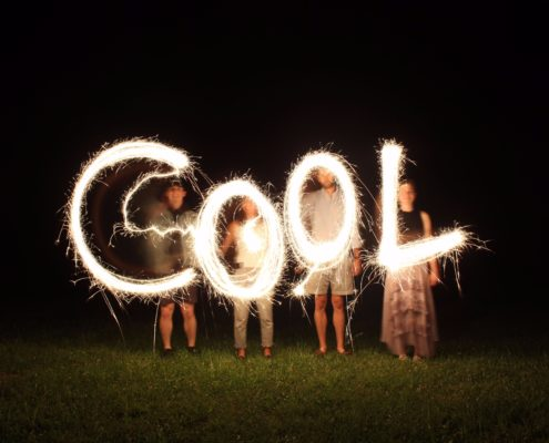 The word cool put together by four people with sparklers