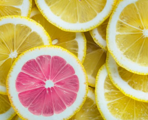 Picture of cut lemons, one is unique with pink innards