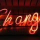 Neon sign on a wall with the word change written
