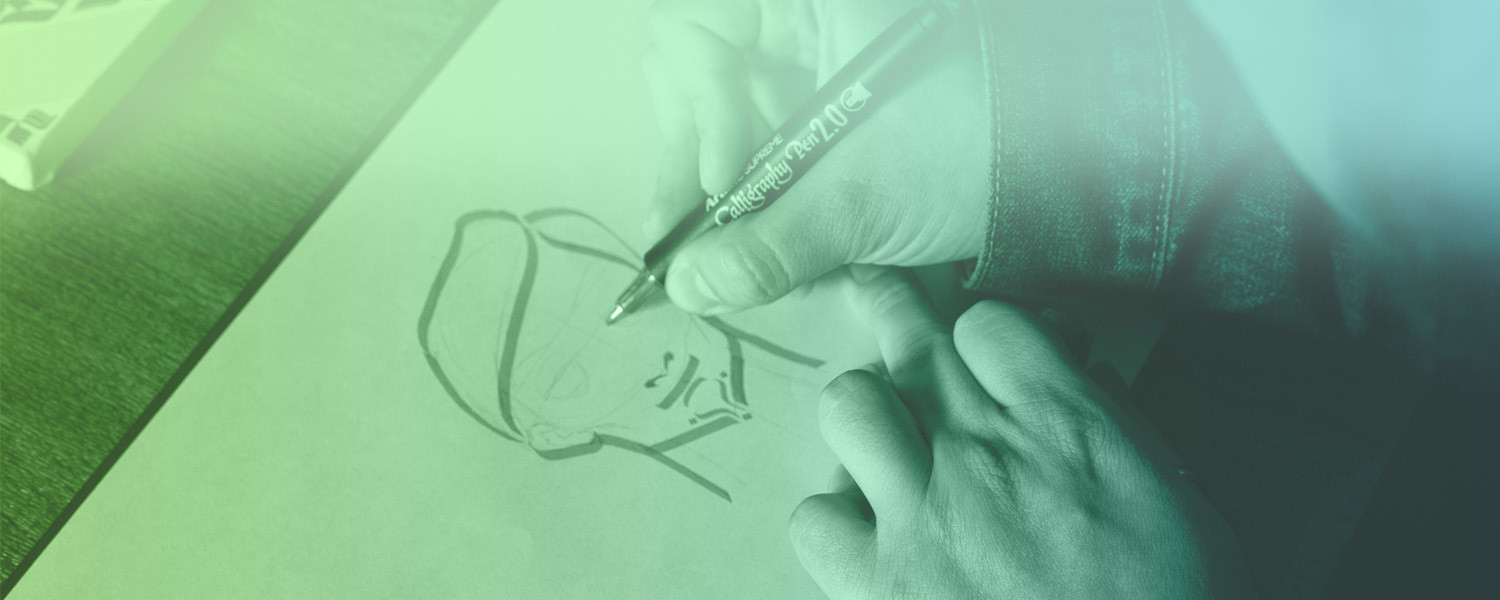 Designers hands sketching a logo icon of a face on a pad